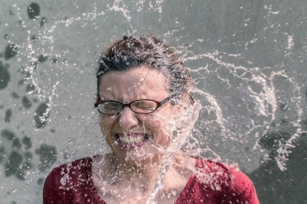 Water splash on face Free Photo