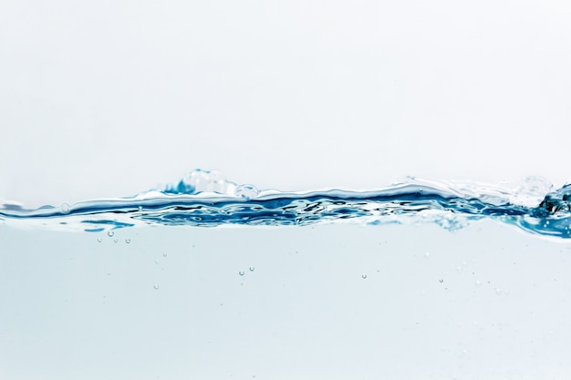 Water splash with bubbles of air, isolated on the white background Premium Photo