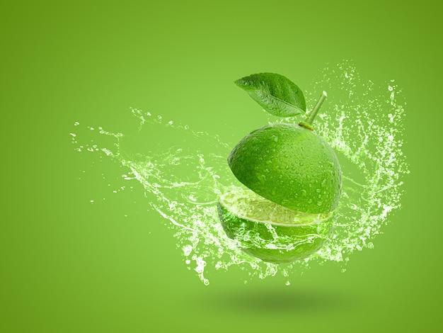 Water splashing on fresh green lime isolated on green background Premium Photo