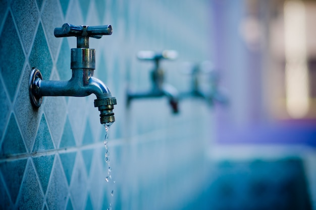 Water tap, save water concept Premium Photo