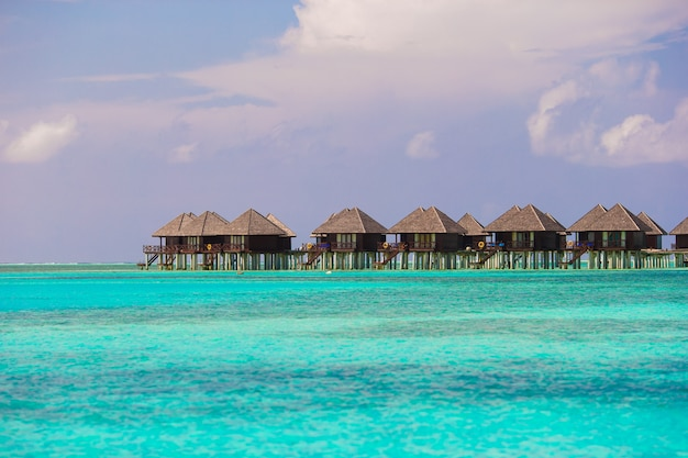Water villas, bungalows on ideal perfect tropical island Premium Photo