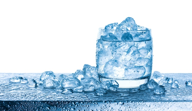 Water with crushed ice cubes in glass on white background Premium Photo