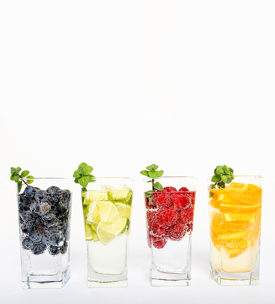 Water with fruit in glasses Free Photo