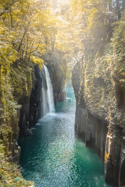 Waterfall and boat at takachiho gorge in takachiho, miyazaki, kyushu, japan Premium Photo
