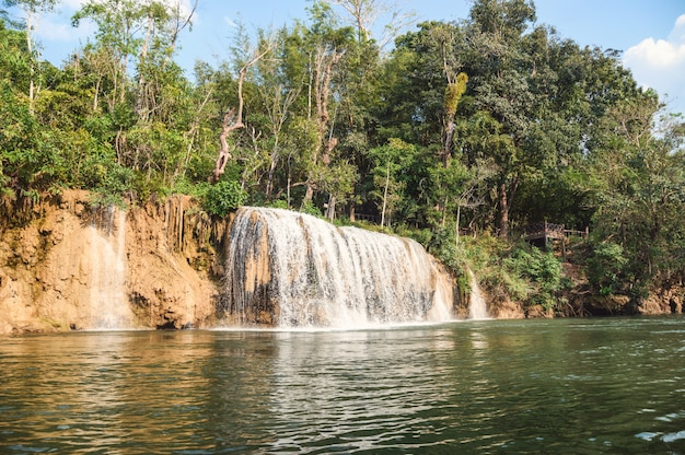 Waterfall flowing on tropical rainforest at national park Premium Photo