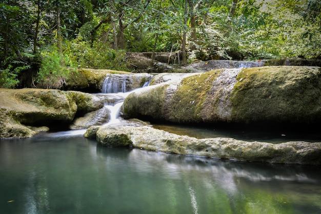 Waterfall hidden in the tropical jungle (erawan waterfall) in kanchanaburi province asia southeast asia thailand Premium Photo