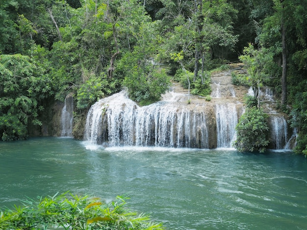 Waterfall and tropical green forest Premium Photo