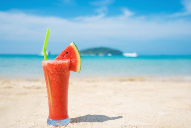Watermelon cocktail on blue tropical summer beach in phuket, thailand. Premium Photo