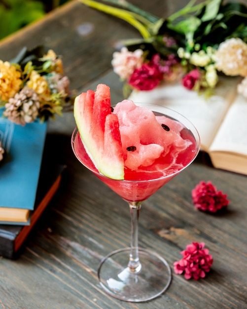 Watermelon cocktail with fruit and flowers. Free Photo