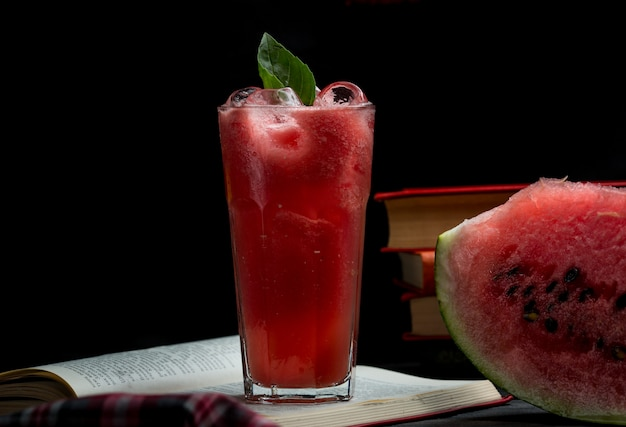 Watermelon ice cold smoothie with mint leaves and a slice of watermelon Free Photo