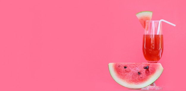 Watermelon juice summer with piece watermelon fruit glass on red background , copy space Premium Photo