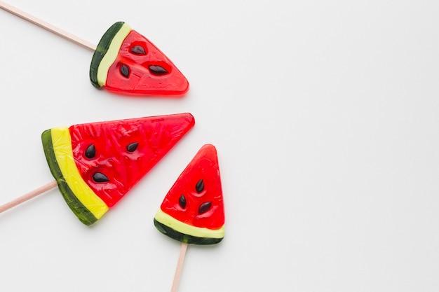 Watermelon lollipops on white table Free Photo