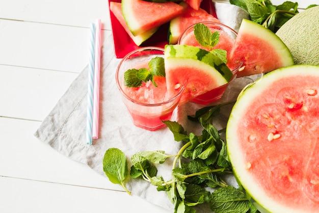 Watermelon mint drinks and straws on napkin Free Photo