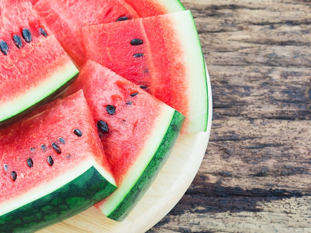 Watermelon on old wooden background Free Photo