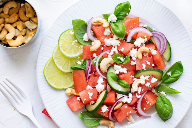 Watermelon salad with cashew nuts and feta Free Photo