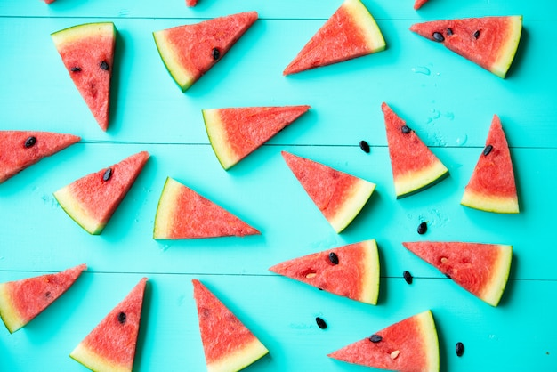Watermelon slices on blue table Free Photo