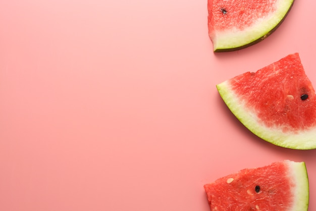 Watermelon slices pink background Premium Photo