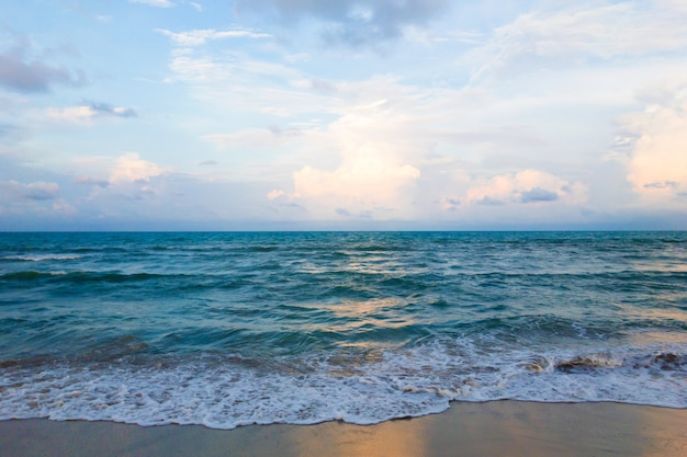 Wave of the sea on the sand beach and beautiful sky Premium Photo
