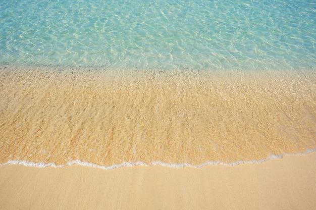 Wave of the sea on the sand beach Premium Photo