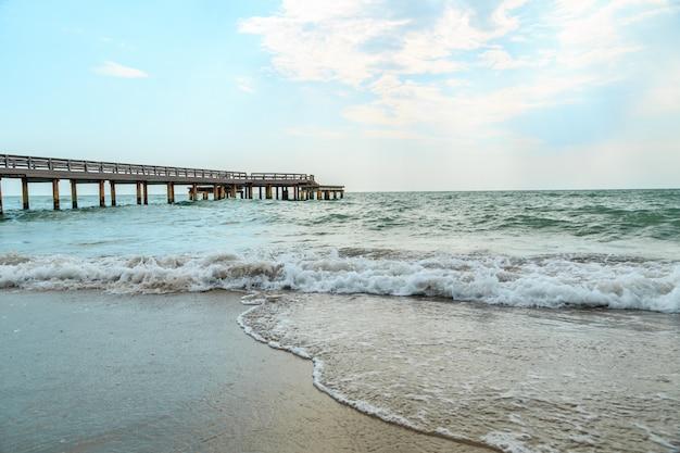 Waves beating on a sandy beach Premium Photo
