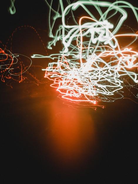 Onde di luci al neon colorate Foto Gratuite