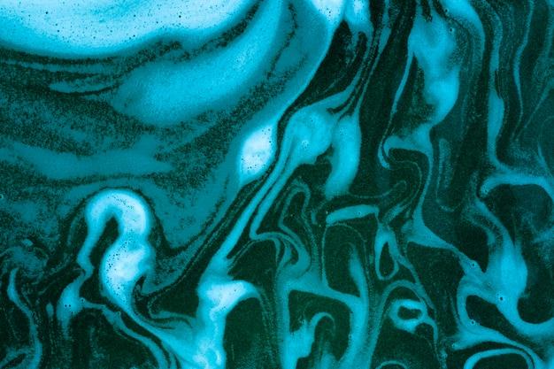 Waves on foam on blue colored liquid Free Photo