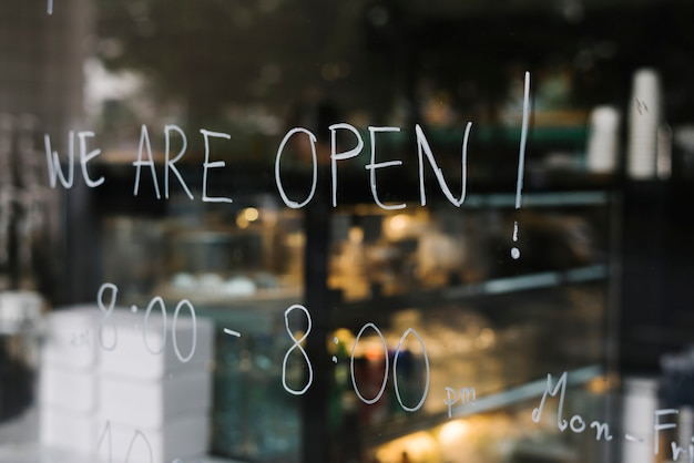 We are open, on a glass wall of a coffee shop Free Photo