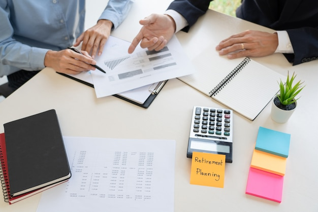Wealth management , business man and team analyzing financial statement for planning financial customer case in office. Premium Photo