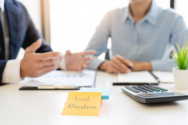 Wealth management concept, business man and team analyzing financial statement for planning Premium Photo