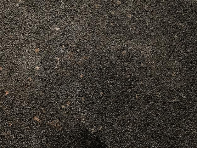 風化した黒いコンクリートの壁の背景 Premium写真