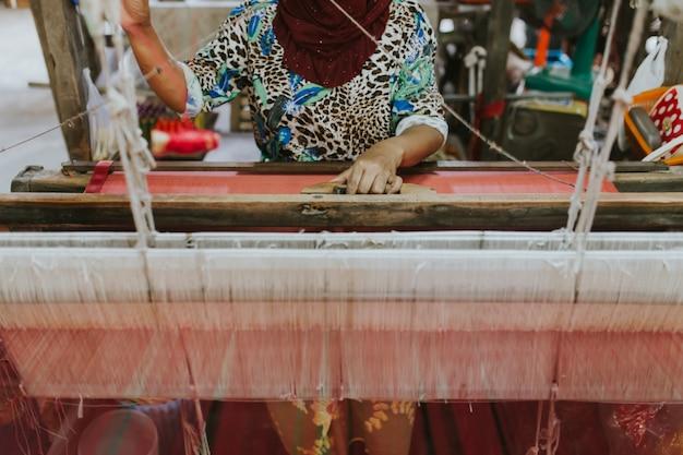 Weaving machine - use for weaving traditional thai silk. Premium Photo