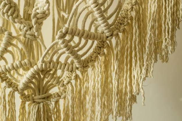Weaving macrame modern needlework in the style of minimalism Premium Photo