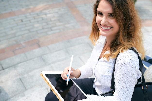 Web designer drawing at the street Free Photo