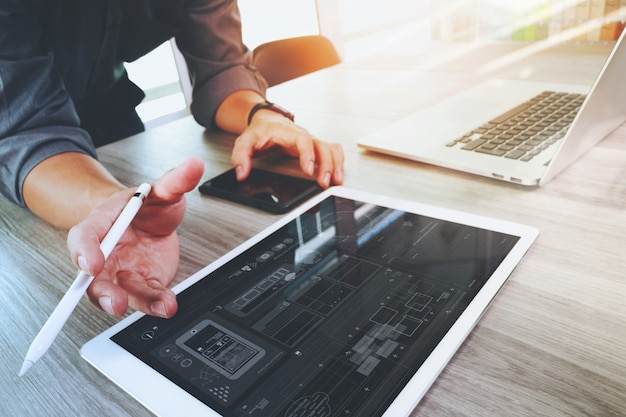 Website designer working digital tablet and computer laptop and digital design diagram Premium Photo