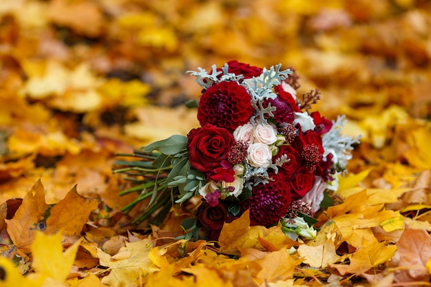 Premium Photo Wedding Bouquet On Autumn Leaves