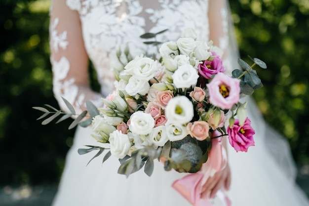 Wedding bouquet in bride's hands Free Photo