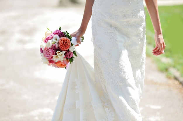 Wedding bouquet in hands of the bride Premium Photo