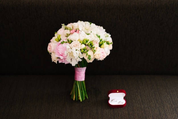 Wedding Bridal Bouquet And Red Box With Wedding Rings On Aark