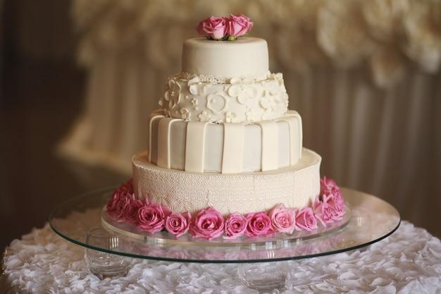 Wedding cake on the table. beautiful colorful sweet wedding cake Premium Photo
