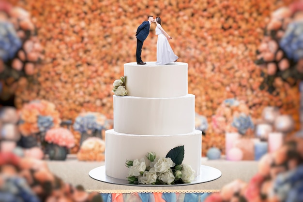 Premium Photo Wedding Cake With Bride And Groom On The Top