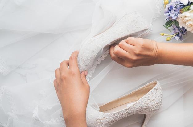 Wedding concept, bride shoes and flowers Premium Photo