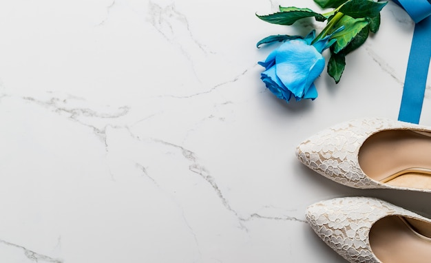 Wedding concept, bride shoes and rose, top view Premium Photo