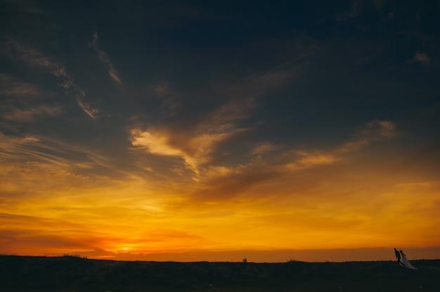 Wedding couple on the background of sunset Premium Photo