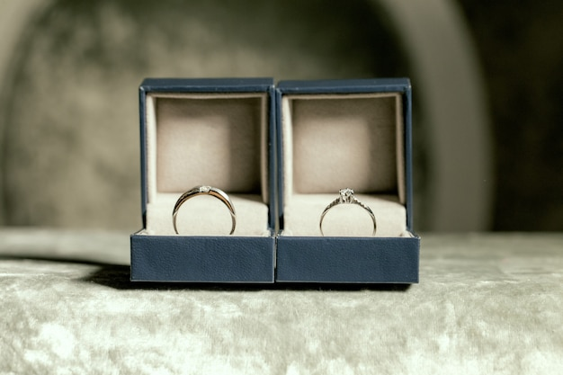 Wedding couple rings placed in boxes Premium Photo