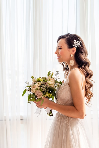 Wedding day. portrait of beautiful bride with bouquet Premium Photo