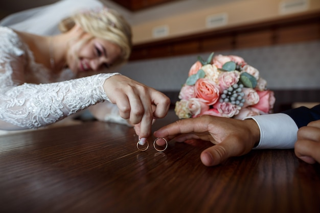 Wedding day. wedding . two wedding rings in the hands of the newlyweds close up. happy bride and groom with their wedding rings Premium Photo