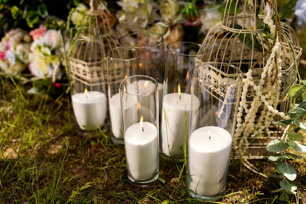 Wedding decor. solemn ceremony. wedding in nature. candles in decorated jars. just married. Premium Photo