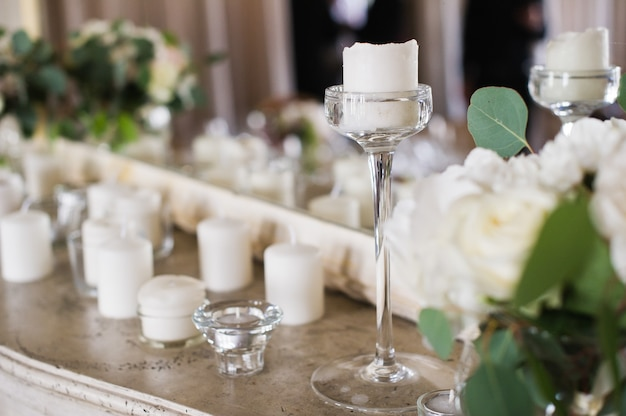 Wedding dinner in the restaurant decorated with candles. Premium Photo