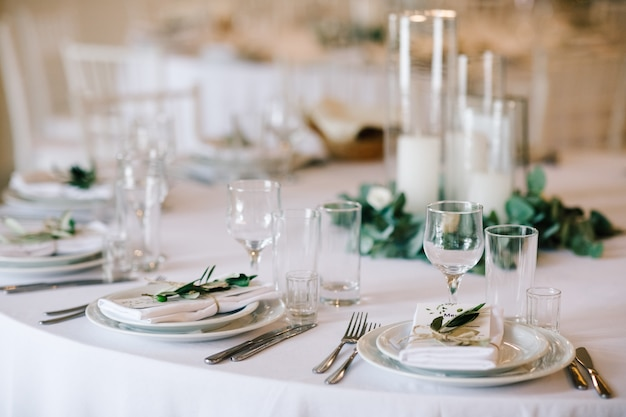 Wedding dinner table set. classy white decor with greenery Free Photo