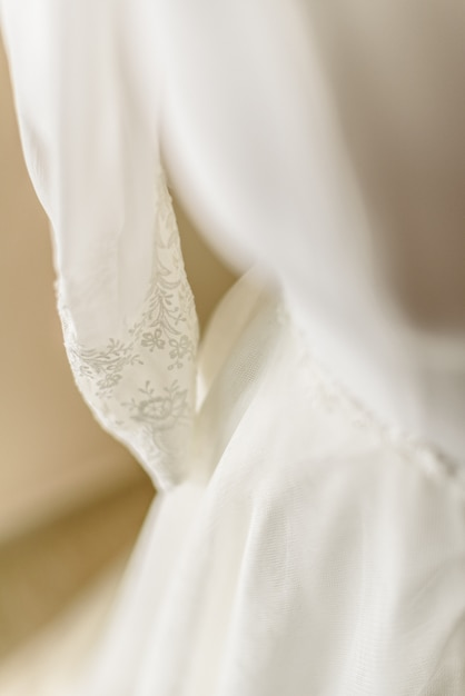 Wedding dress placed in a mannequin ready to dress her the bride. Premium Photo